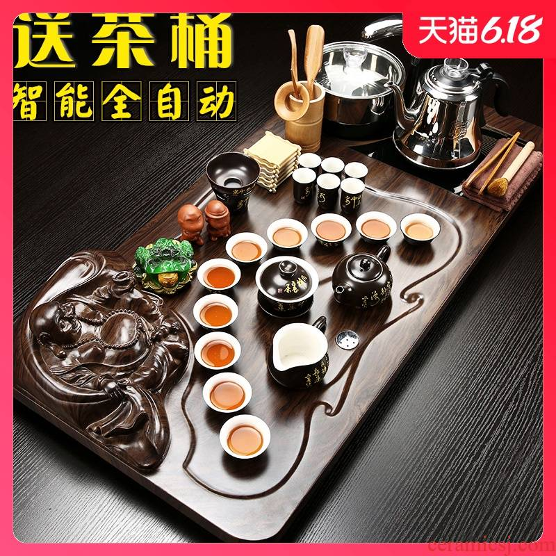 Sand embellish tea set suit household contracted automatic violet arenaceous kung fu of a complete set of the joining together of four solid wood tea tray, tea tea taking
