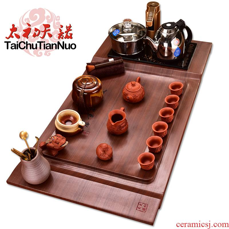 The beginning day, stone tea tray was four one red TanShi tea tea set live purple sand pottery kung fu tea furnace