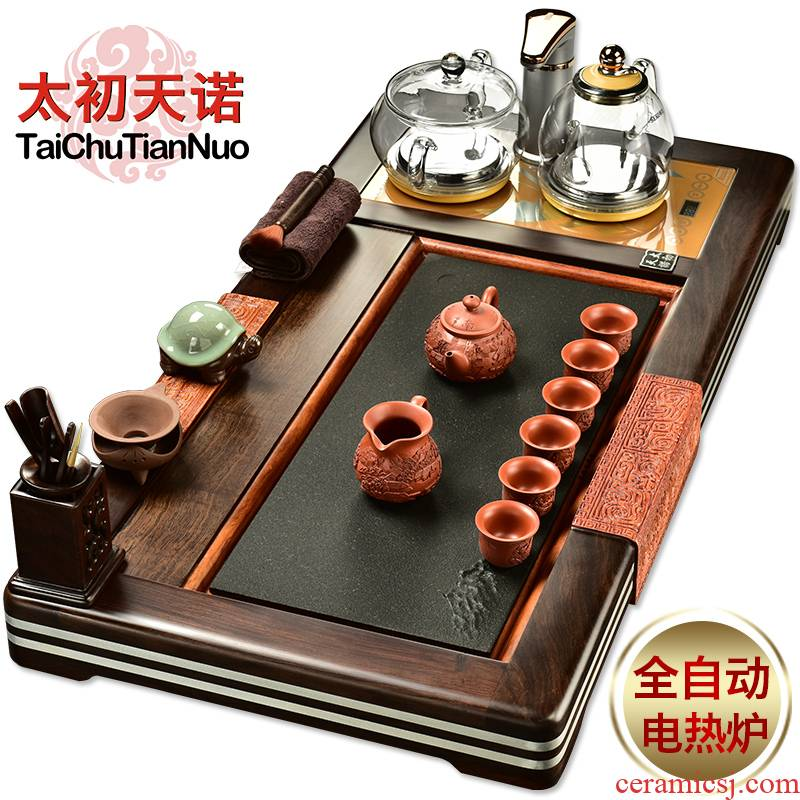 The beginning day, violet arenaceous kung fu tea set four unity of a complete set of automatic sodium silicate on The pot of ebony tea tray
