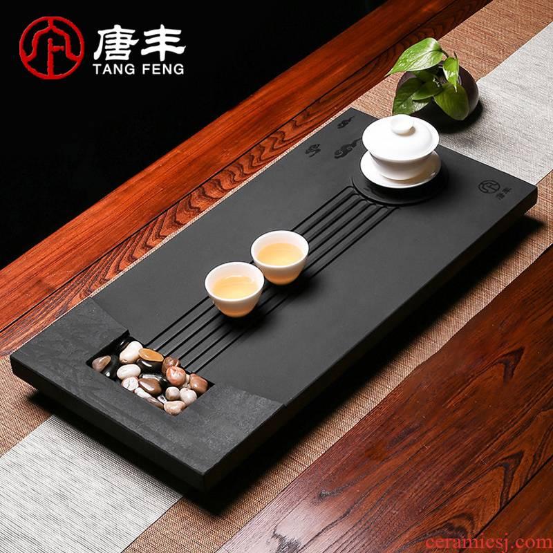Tang Feng blocks sharply stone tea tray household contracted stone tea black stone, stone, fire large drainage tea sea