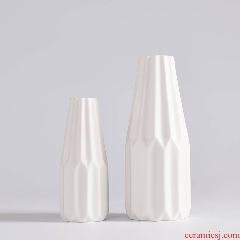 Two modern creative household act the role ofing is tasted furnishing articles contracted white ceramic vases, small and pure and fresh flower arranging flower art to the desktop