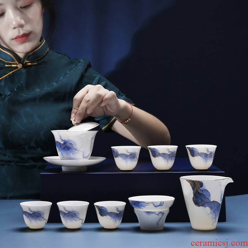 The Poly real scene dehua high - end white porcelain kung fu tea set golden years ink contracted only three tureen gift set