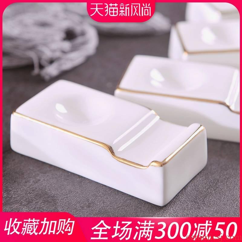 Jingdezhen creative manual gold 】 【 up phnom penh ipads China chopsticks pillow chopsticks ceramic tableware restaurant hotel chopsticks holder frame