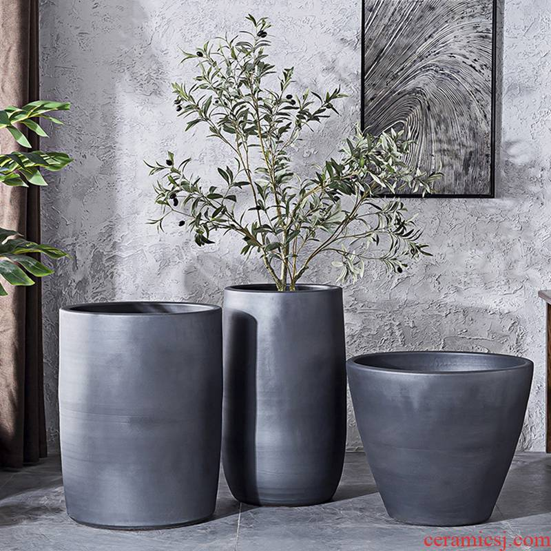 Black ceramic vase hydroponic water lily basin tank cylinder flowerpot planting large courtyard green plant in northern Europe interior decoration