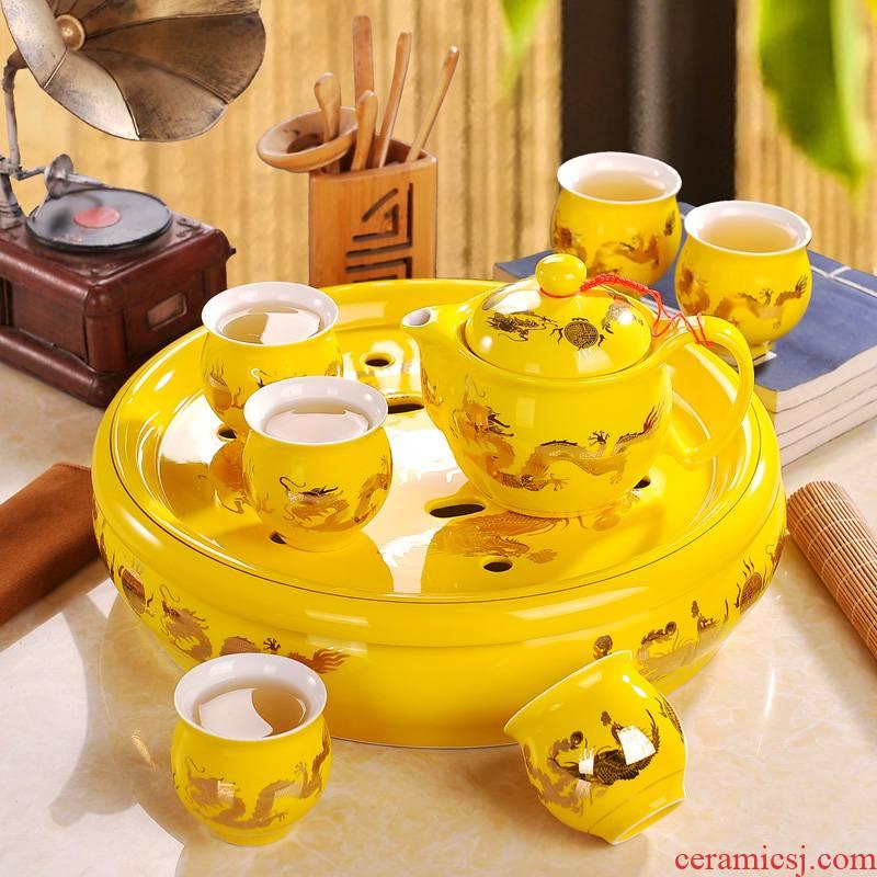 Jingdezhen ceramic tea set home round yellow longfeng kung fu tea tea tea tray was a complete set of the teapot