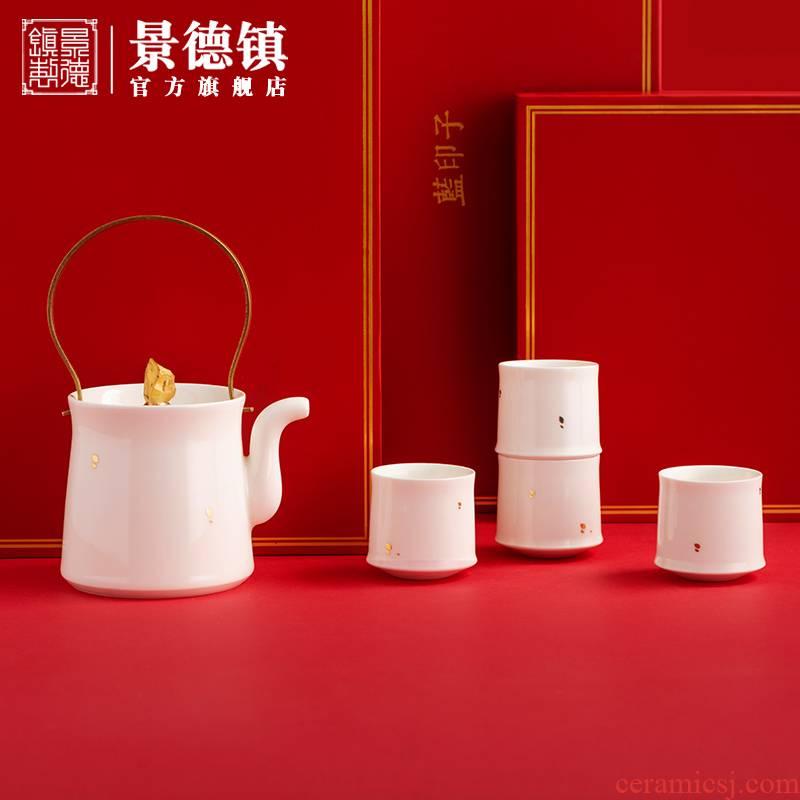 Jingdezhen flagship store of ceramic tea set suit household manual white porcelain teapot teacup fair keller a pot of four cups