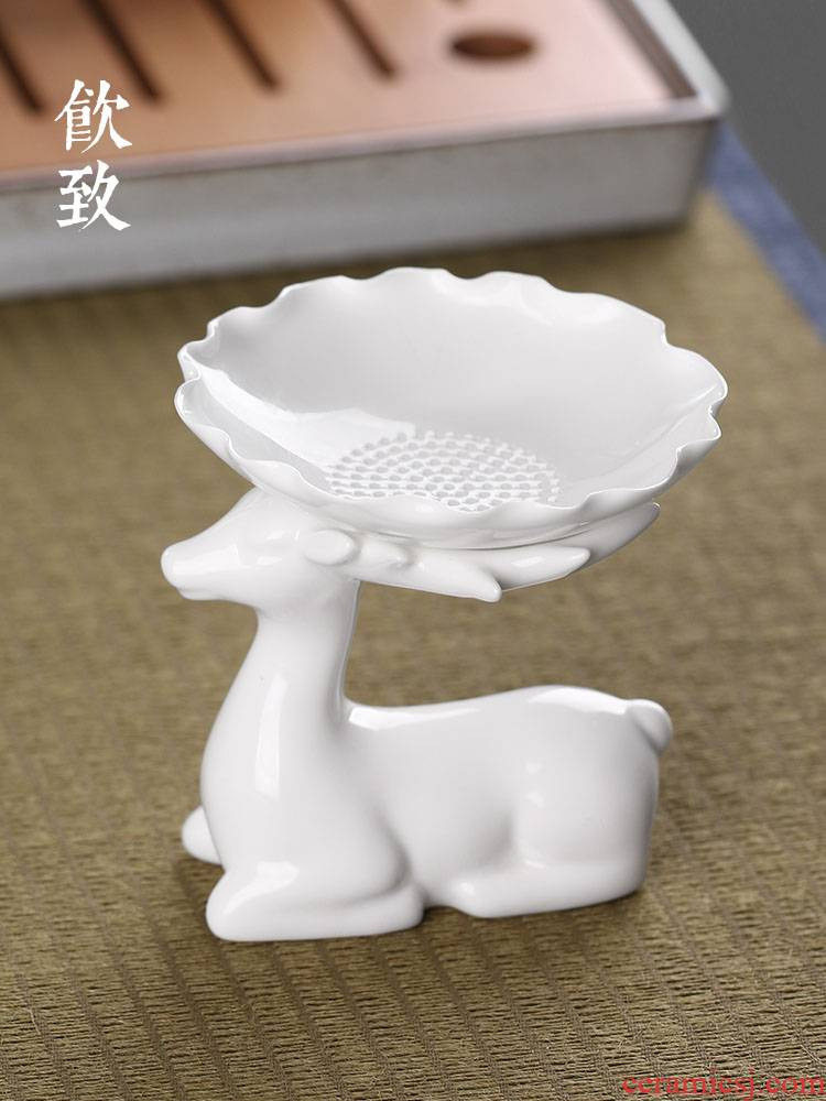 Ultimately responds to creative white porcelain tea tea filter filter manual rack) ceramic tea set tea components of tea