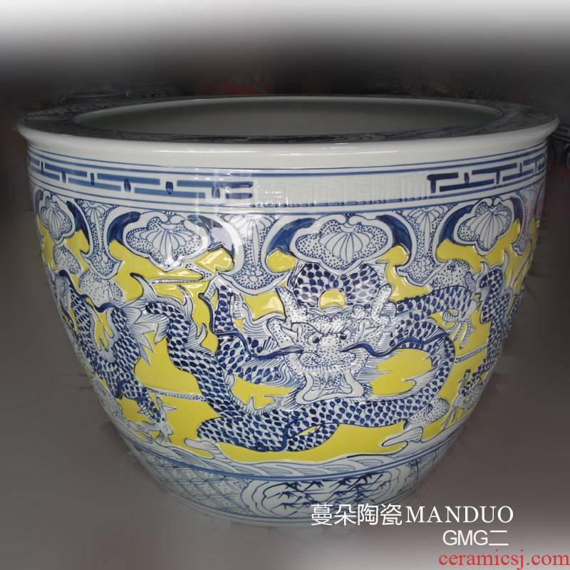 Jingdezhen yellow bottom emboss dragon China cylinder diameter 50-70 wulong China painting and calligraphy in yellow dragon cylinder