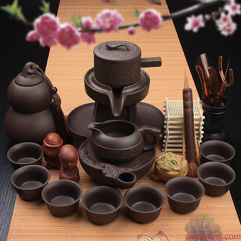 Lazy stone mill tea set ceramic violet arenaceous household kung fu suit all semi - automatic hot tea cups creative tea POTS