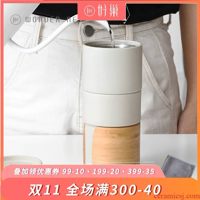 Good nest mu en personal hand suit with a cup of coffee pot ceramics drip cup of filtered coffee appliances
