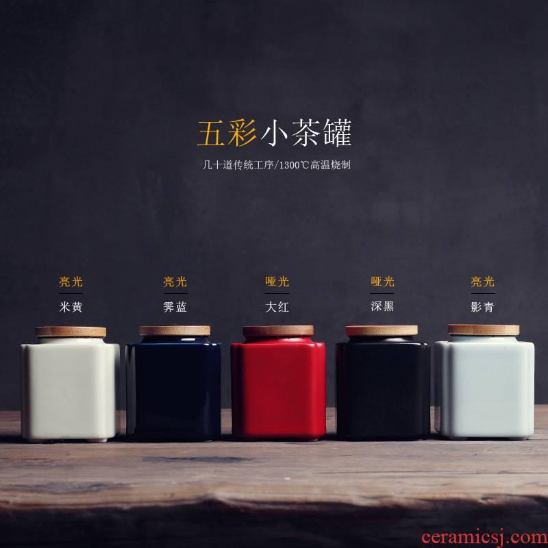The ceramic tea canister mini jar airtight pu 'er tea pot black Chinese wolfberry powder pot small portable storage tanks