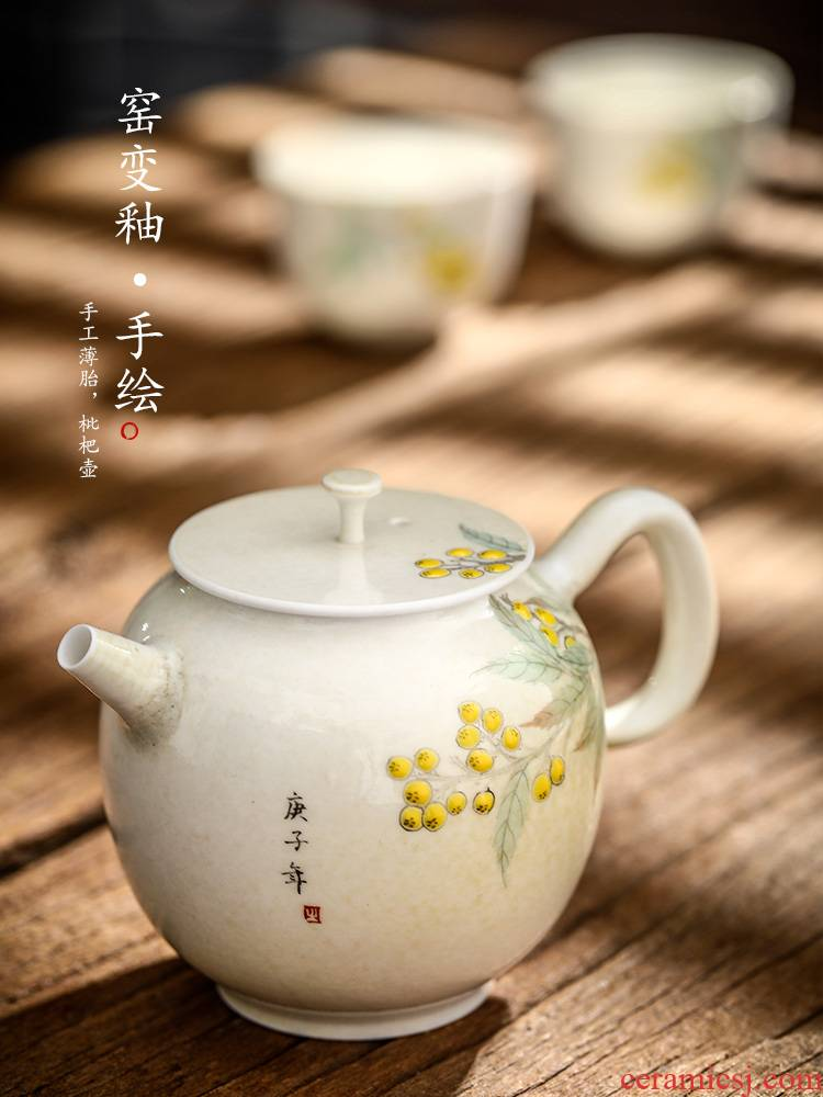 Jingdezhen tea pot pot of pure manual hand - made loquat kunfu tea ball hole ceramic small pot of creative Chinese thin body