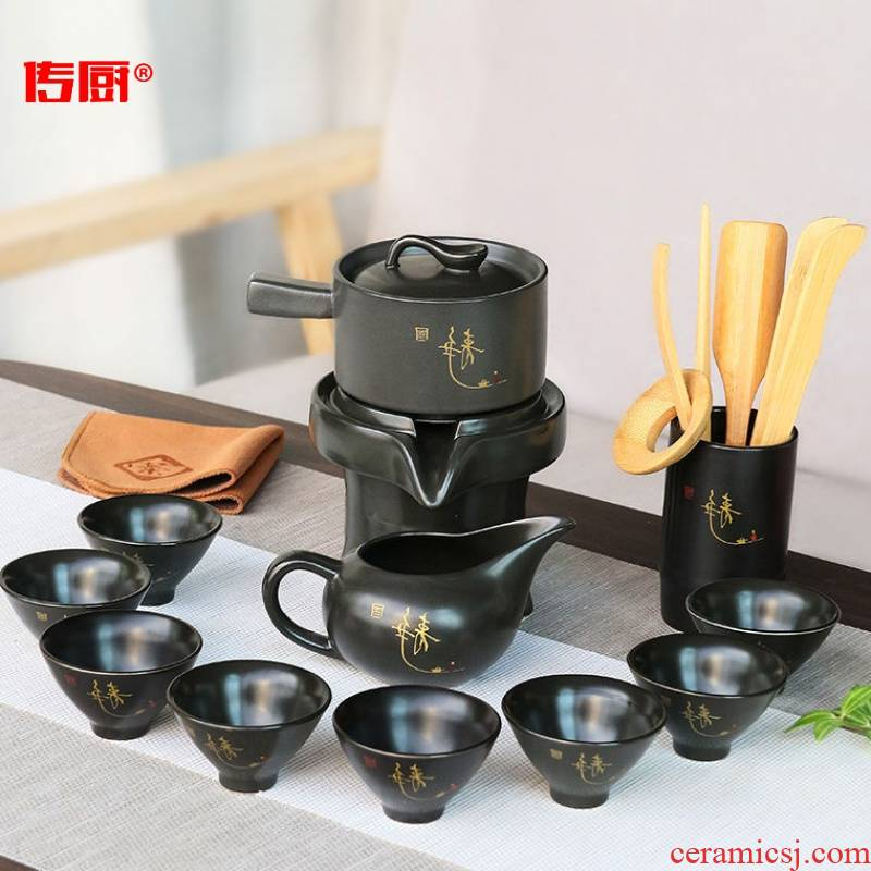 The kitchen household ceramic teapot rotating out of The water of a complete set of lazy semi - automatic purple sand tea set suit creative kung fu