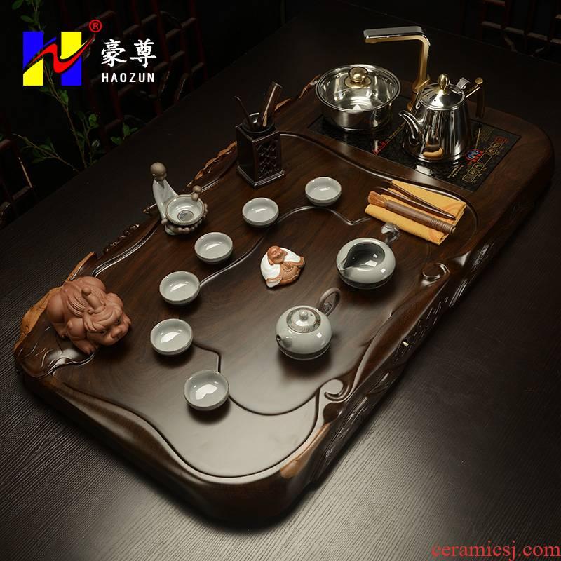 Shadow enjoy a complete set of ebony wood tea tray was kung fu tea sets purple elder brother up four unity induction cooker tea HZ
