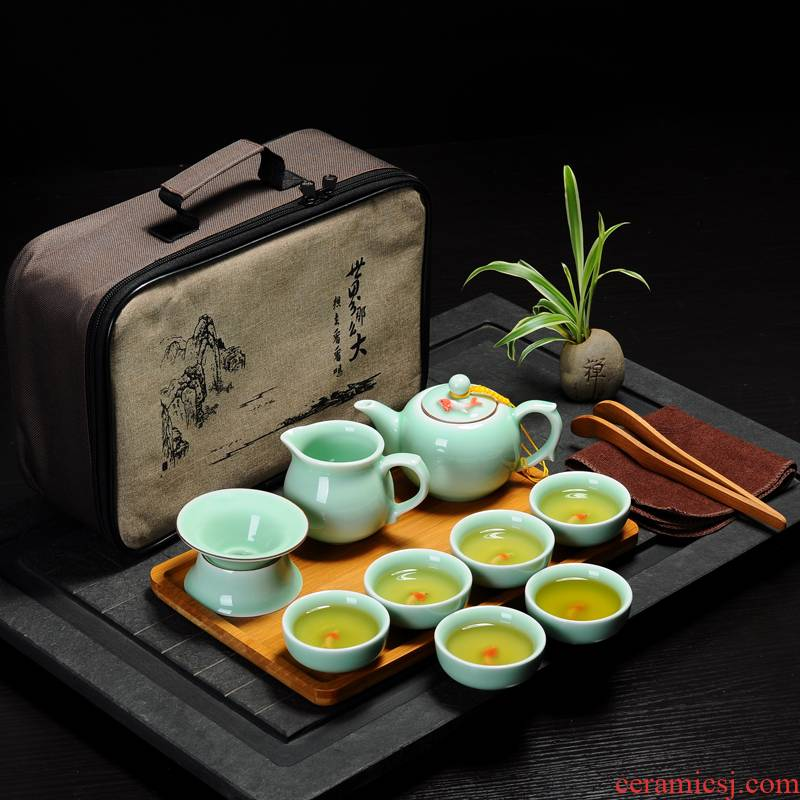The Receive travel kung fu tea set is suing travel bag portable celadon carp cup crack cup a pot of two cup