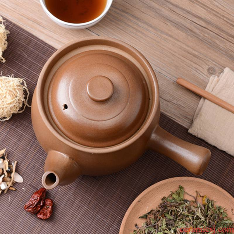 Old ceramic tisanes pot of traditional Chinese medicine (TCM) household TCM sand pan pot stew boil herbs put the earth pot
