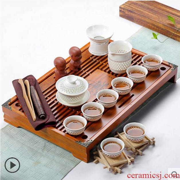 A complete set of ceramic tea set household kung fu tea cup solid wood tea tray tea tea accessories tea bag sea mail