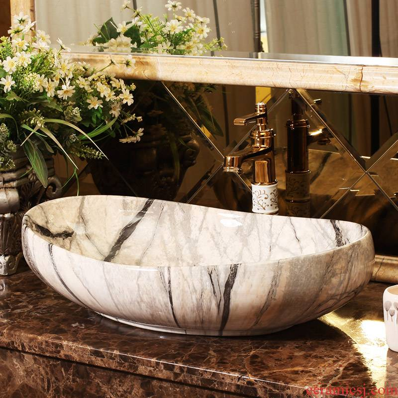 Marble basin stage art oval European - style bathroom ceramic lavatory basin that wash a face to wash your hands of household balcony