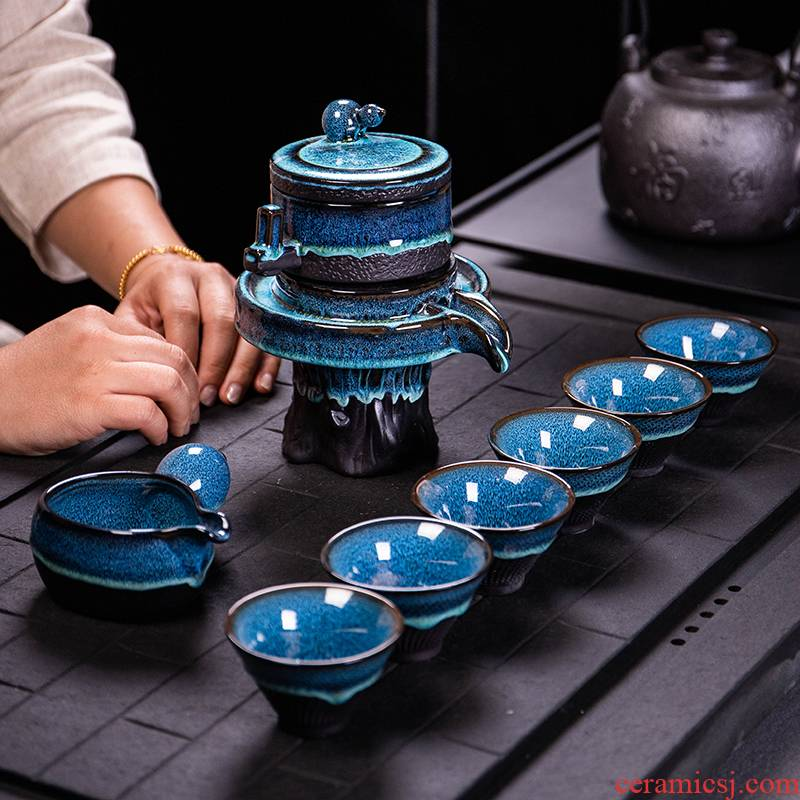 Ya xin $# up tea set home lazy semi - automatic creative stone mill kung fu tea, building ceramic lamp