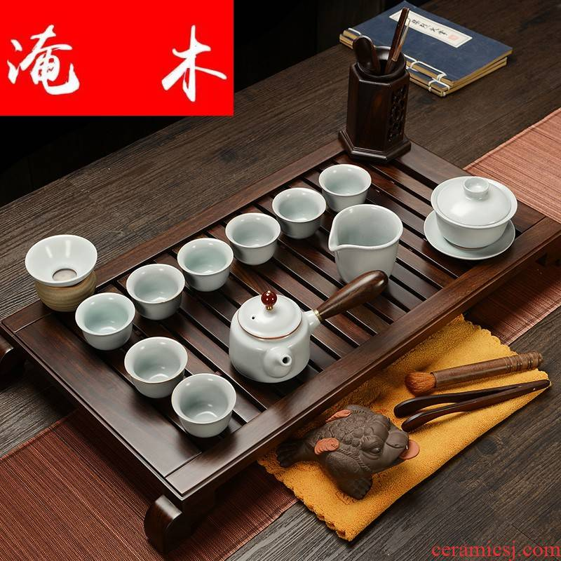 Flooded purple sand pottery and porcelain of a complete set of household solid wood ebony wood tea tray was Chinese tea tea art kung fu tea set