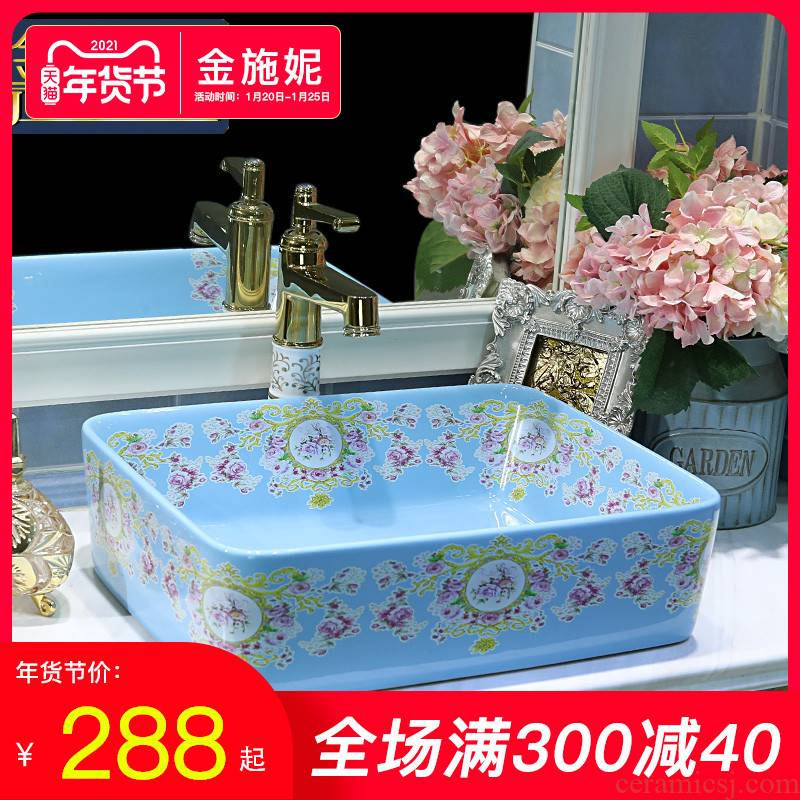 Gold cellnique contracted on the blue square lavatory basin of modern European art ceramic toilet basin that wash a face