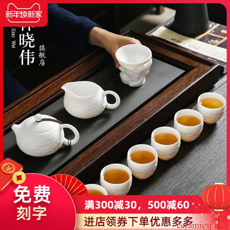 Dehua suet jade biscuit firing manual white porcelain kung fu tea set suit household ceramic teapot of a complete set of tea cups
