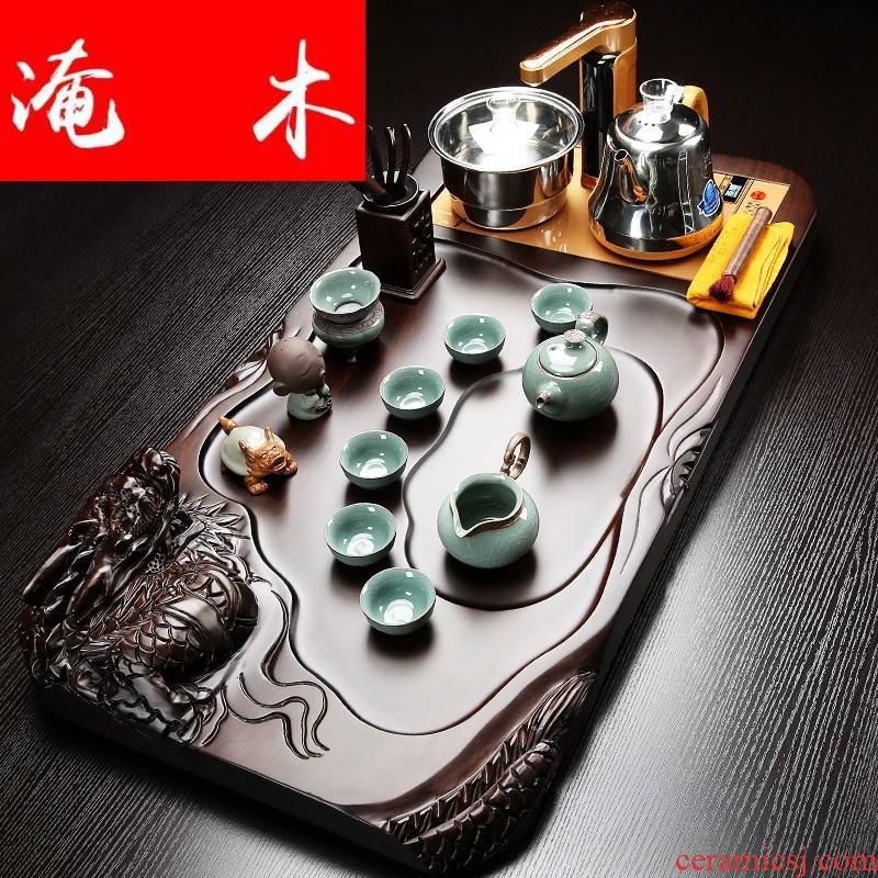 Flooded the whole piece of ebony wood tea tray was the home of a complete set of violet arenaceous kung fu tea set four unity induction cooker tea set