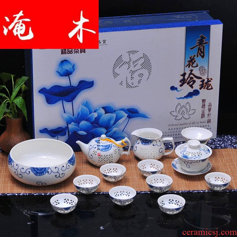 Submerged wood jingdezhen porcelain and exquisite hollow ceramic kung fu tea set contracted high - grade ipads China gift of a complete set of cups