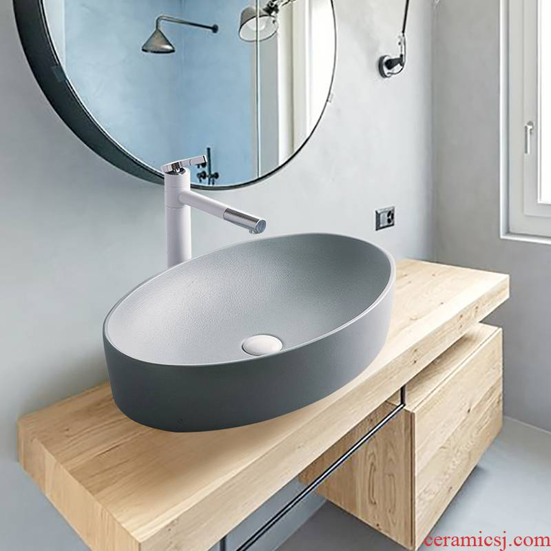 The stage basin to single Nordic ceramic face basin household birdbath simple toilet lavabo balcony lavatory basin