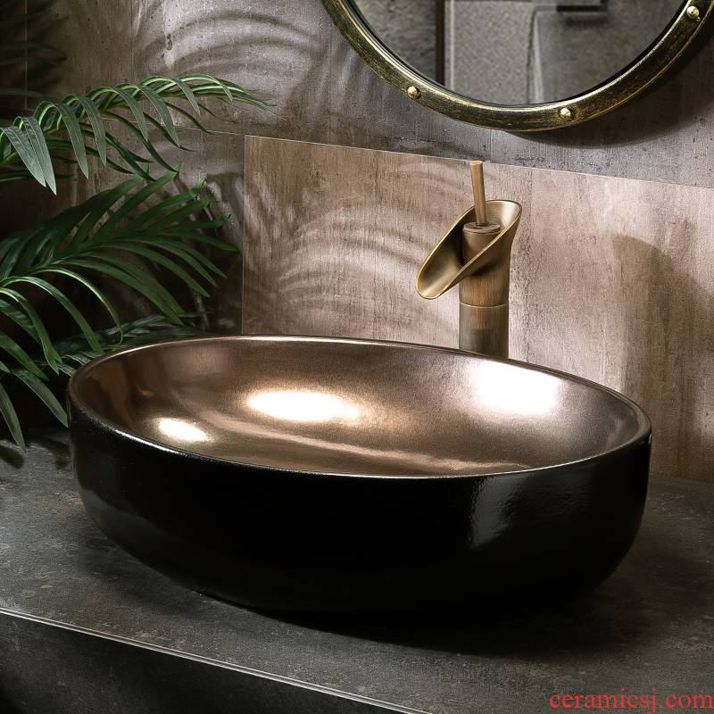 Jin tai on the sink basin of single elliptic toilet inside the black outside northern wind household art ceramic basin is small