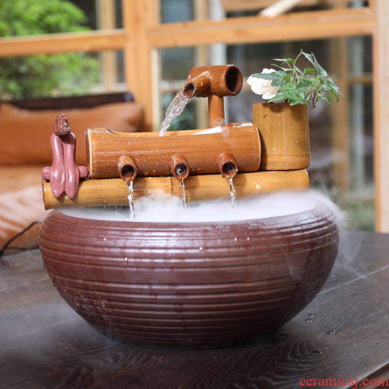 Into which the circulating water tank water bamboo furnishing articles to spill water exchanger with the ceramics filter water plutus office