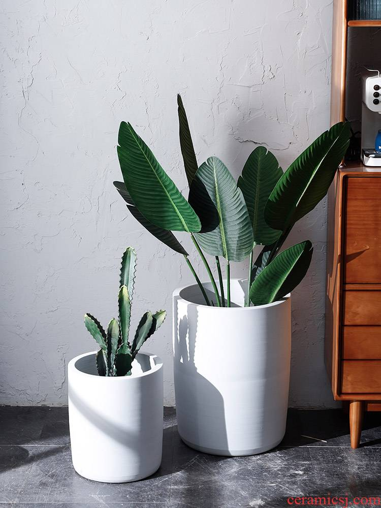 The Nordic ceramic flower pot flower bed pure white modern indoor and is suing decoration to heavy green plant planting place flowerpot