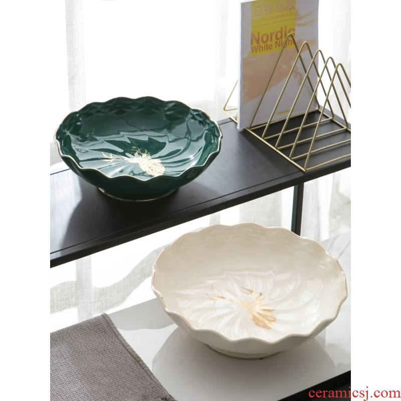 Modern creative home sitting room tea table dry fruit tray was high - grade move light and decoration ceramics of confectionery receive dish
