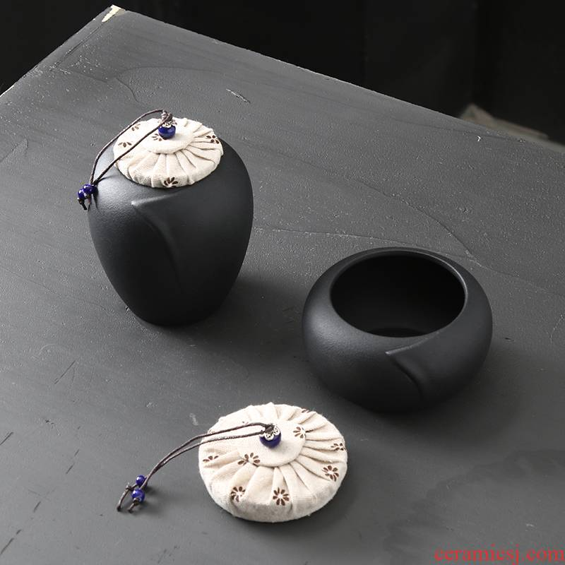 Japanese black pottery round collar seal tank storage tank to the receive tank household candy jar coffee jar ceramic tea pot