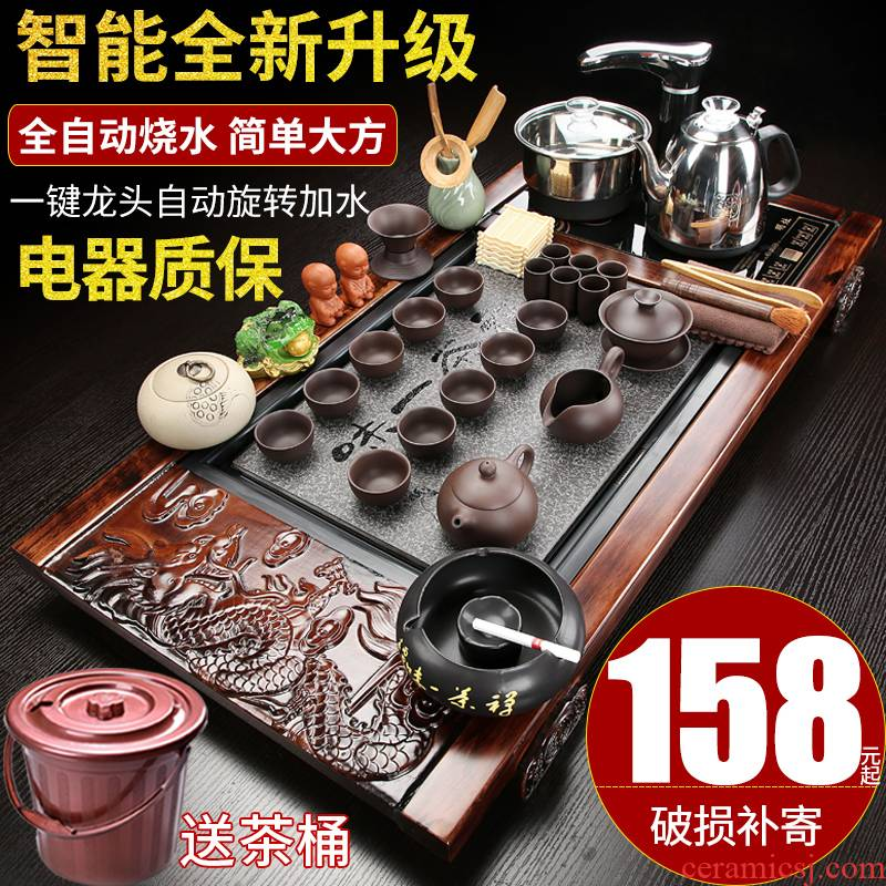 Hui shi violet arenaceous kung fu tea set home sitting room is contracted ceramic tea cups of tea a automatic solid wood tea tray