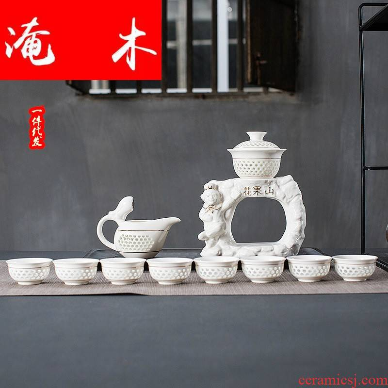 Submerged wood and exquisite hollow out of a complete set of semi - automatic kung fu tea set tureen tea art ceramic creative teacups premium gift