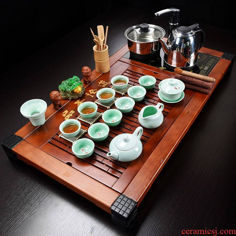 The hutch of a complete set of solid wood tea tray package ceramic kung fu tea tea set household contracted with integrated electric magnetic mixture furnace