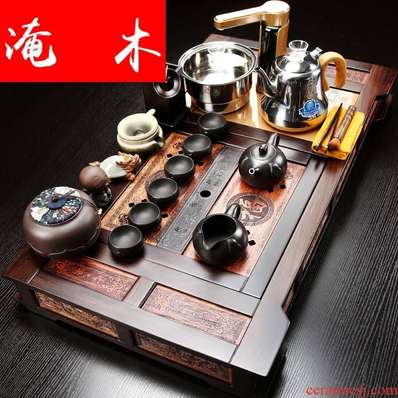 Flooded ebony wood tea tray was violet arenaceous kung fu tea set four unity of a complete set of automatic induction cooker household tea set