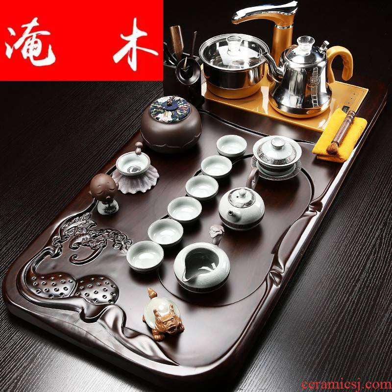 Flooded the whole household contracted purple sand tea set ebony wood tea tray automatic induction cooker four one tea table