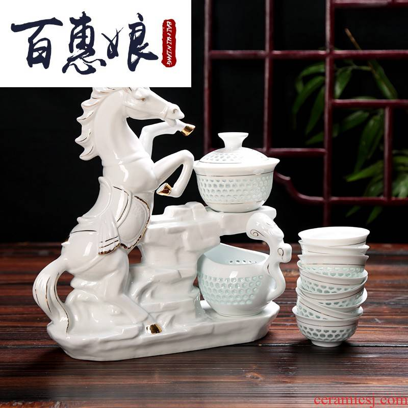 (niang and exquisite hollow out automatically make tea tea set lazy of blue and white porcelain ceramic kung fu gift box office