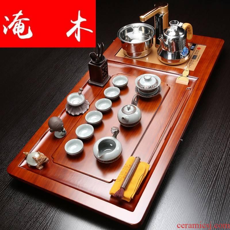 Submerged wood blocks hua limu tea tray and four automatic induction cooker purple ceramic kung fu tea set
