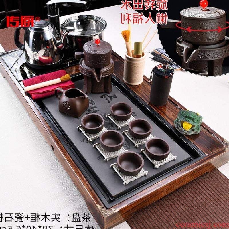 The kitchen kung fu tea set home a whole set of high - grade automatic solid wood tea tray zisha teapot teacup tao