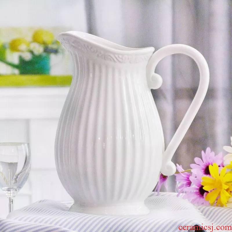 China continental white porcelain creative Mediterranean hydroponic flowers white blue milk pot blue ceramic flower arranging flowers