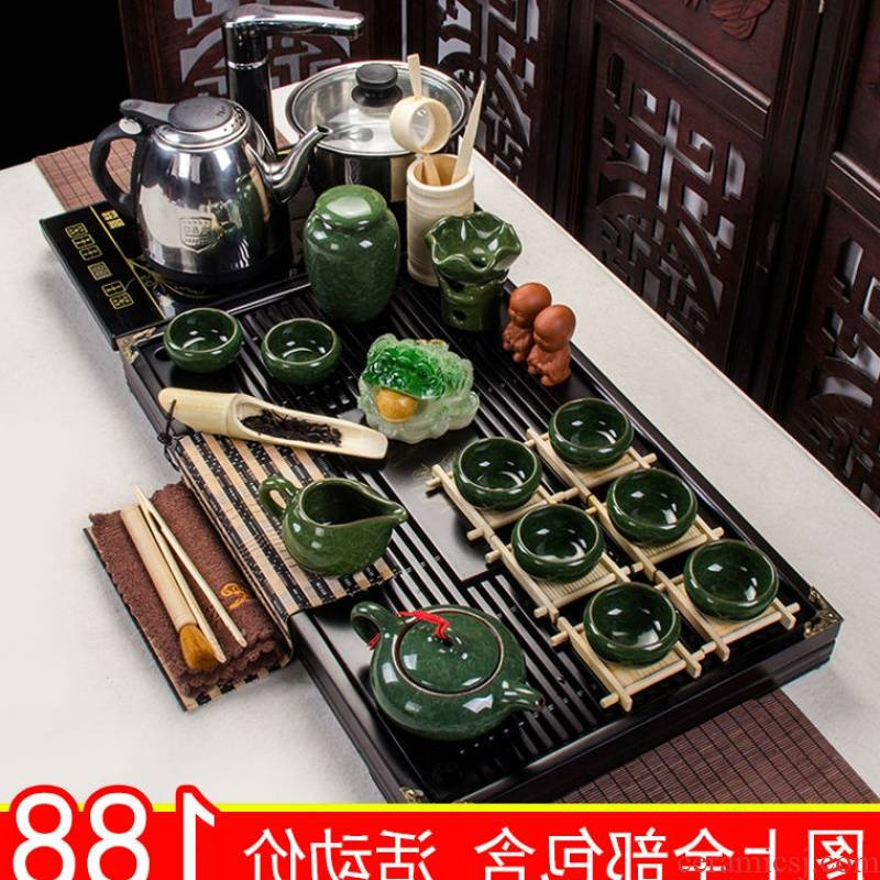 The kitchen kung fu tea set of household ceramic with a complete set of automatic solid wood tea tray was purple sand teapot teacup