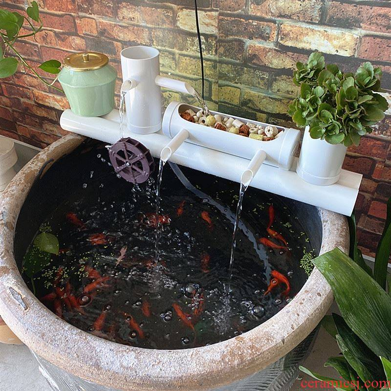 Porcelain jar filter tank placed on circular pump water fish small stone runnel tile water circulation of increasing oxygen cylinder