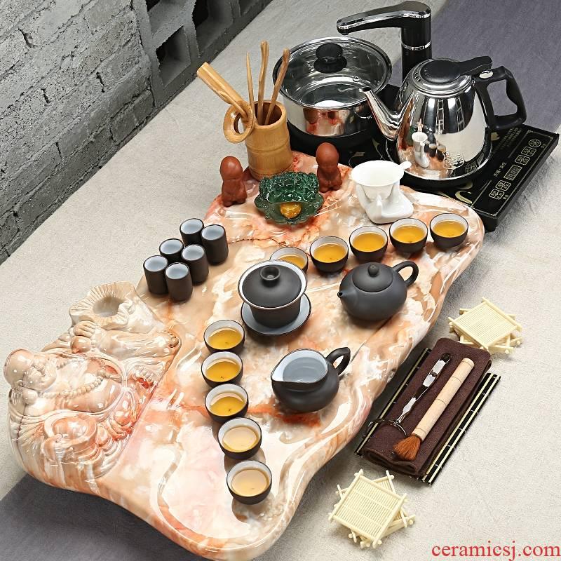 Qiao mu water stone tea set purple ice crack of a complete set of kung fu tea tea tea tray was four unity of electric heating furnace
