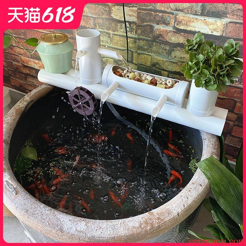 Aquarium filter water circulating water device placed on porcelain jar into which the circular cylinder - oxygen fish small filter pump